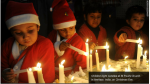 Kids lighting Christmas candles